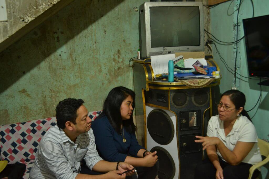 Pioneer Microinsurance staff in dialogue with a customer
